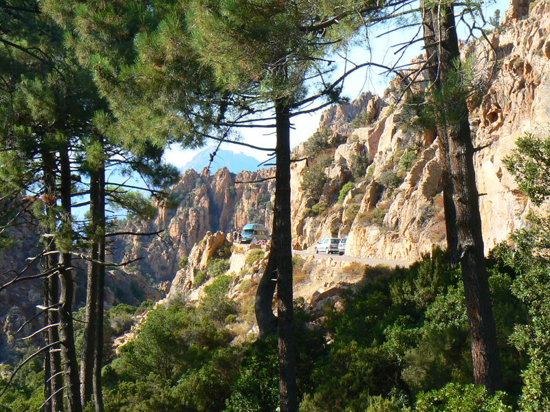 The narrow road through the colorful rock formations of Les Calanques de Piana