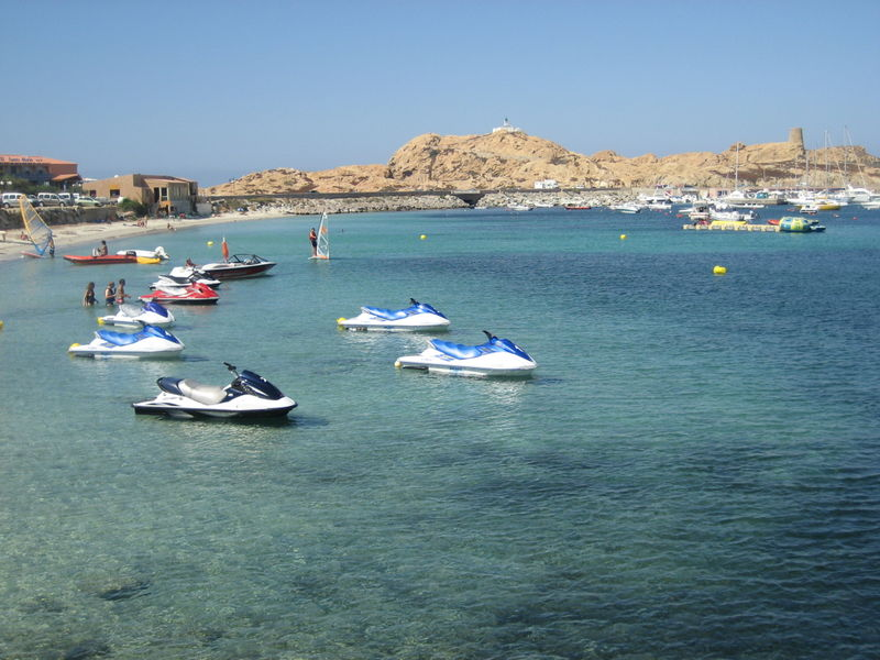 The red granite rocks in the bay of L'Île Rousse, Corsica
