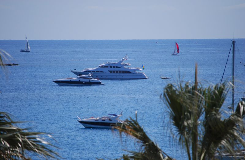 The luxury yacht, Paradigm, moored in la Baie des Anges in Antibes, right in front of our apartment. [Photo by Michael DeMoney]