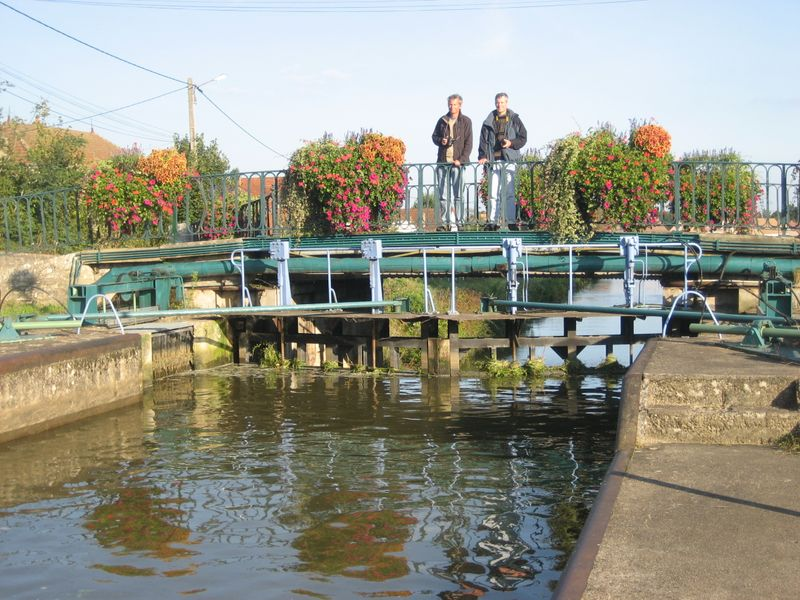 Mike & Dave DeMoney standing on a lock bridge in Burgundy
