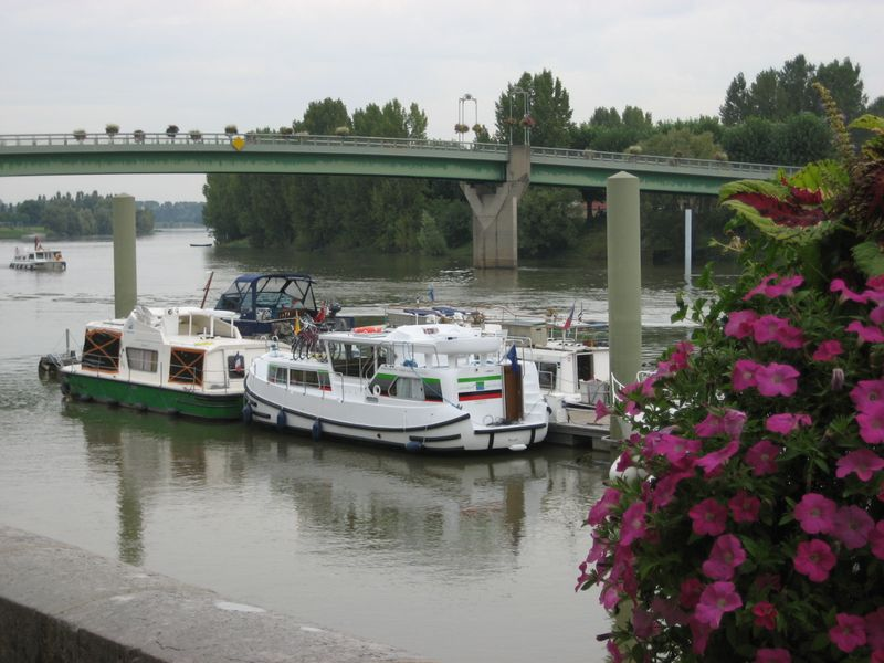 L'Abbaye, our pénichette, is moored under the Pont de Tournus on the River Saône