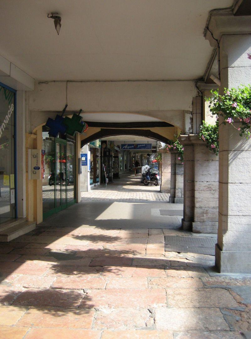 A glimpse under one of the 157 arcades in the village of Louhans in Burgundy