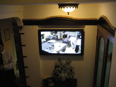 Flat-screen television view of the kitchen in Ristorante Il Buco