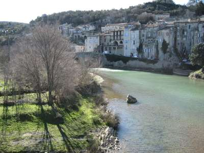 The Cévenol village of Sauve with its medieval buildings sitting above the Vidourle river