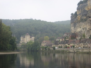 Canoeing down the Dordogne River through the village of La Roque-Gageac